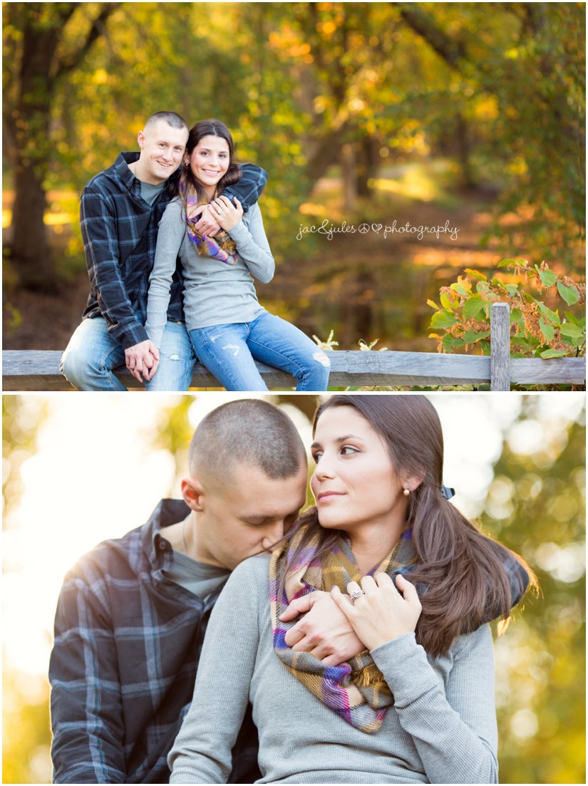 Engaged couple sitting on fence at Allaire State Park in NJ photographed by JacnJules
