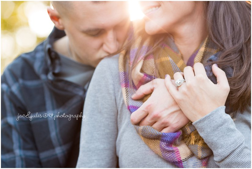 Beautiful candid of engaged couple and close-up of ring photographed by JacnJules at Allaire State Park in NJ