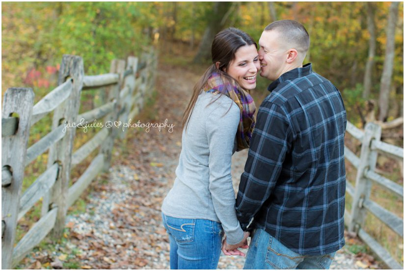 Happily engaged couple walking the trails of Allaire State Park in NJ photographed by JacnJules