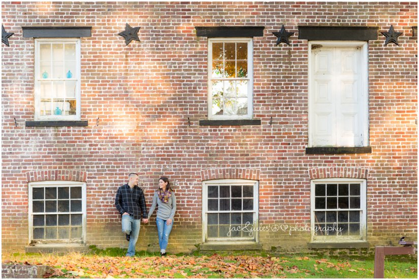 Modern engagement photo of couple against brick building in Allaire State Park in NJ by JacnJules