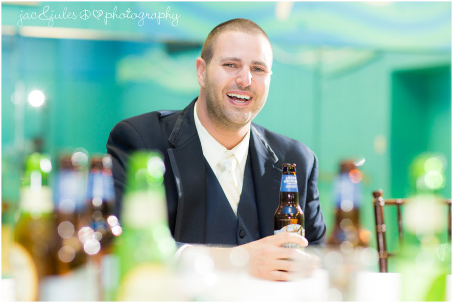 Candid shot of groom before wedding at Frogbridge in Millville, NJ by JacnJules