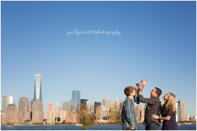 Scenic family photo against NYC skyline photographed by JacnJules at Liberty State Park in Jersey City, NJ