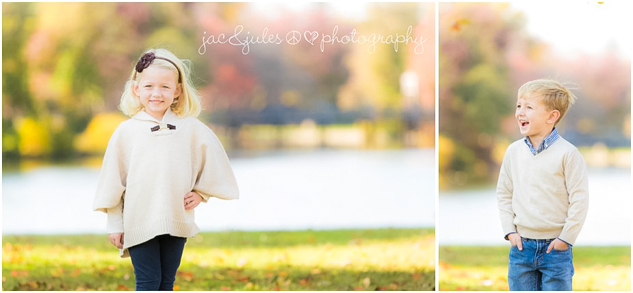 Siblings in white fall sweaters in front of gorgeous lake at Divine Park in Spring Lake, NJ by JacnJules