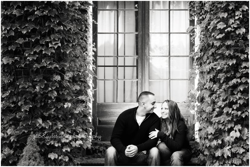 Modern black and white engagement photo under trellis at Spring Lake in NJ by JacnJules