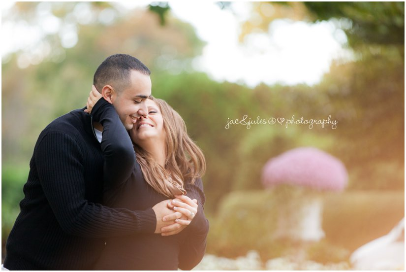 Romantic photo of engaged couple at Spring Lake in NJ photographed by JacnJules