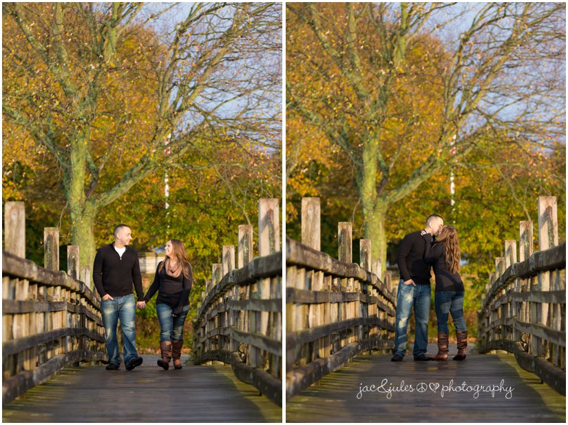 Couple walking along wooden bridge at Spring Lake in NJ by JacnJules