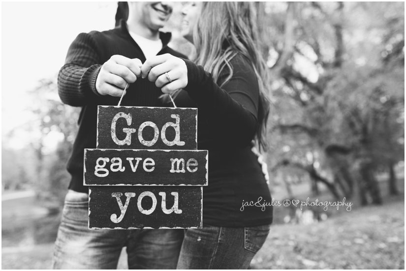 "Couple holding ""God gave me you"" sign during engagement session at Spring Lake in NJ photographed by JacnJules"