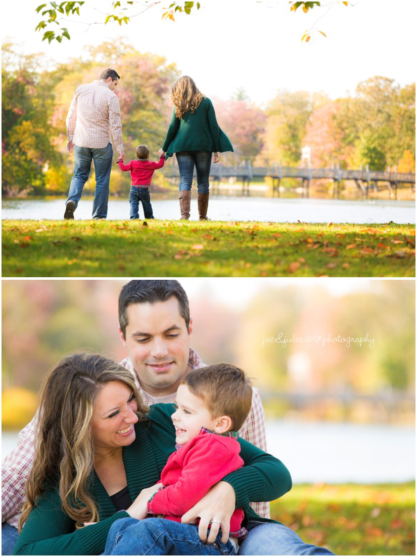 Mom and dad with son in fall outfits taken in front of lake at beautiful Divine Park in Spring Lake, NJ by JacnJules