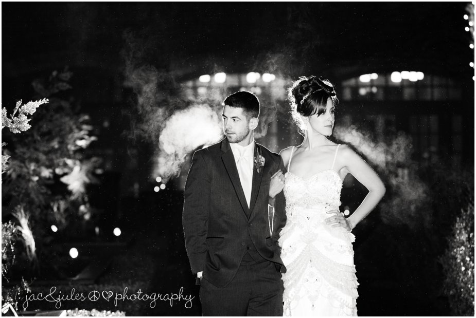 jacnjules photographs bride and groom outside in the rain at night at ninety acres at natirar in peapack gladstone