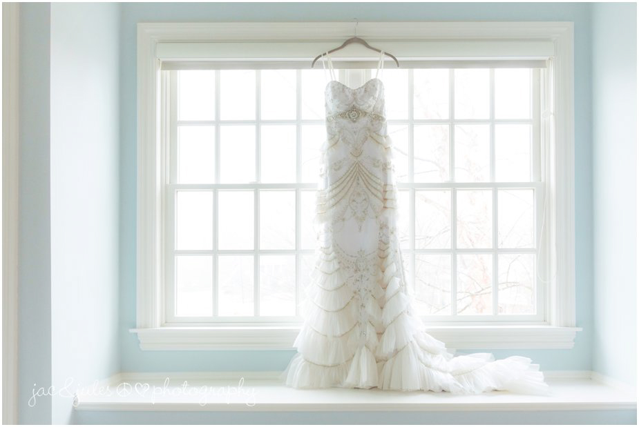 jacnjules photographs Lazaro bridal gown, wedding dress in a big window at their home in franklin lakes, nj