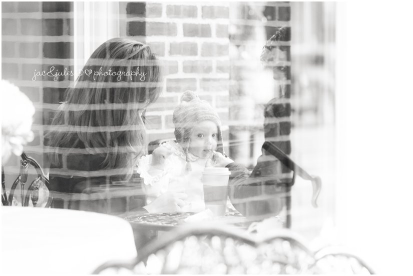 a photo of a family at a cafe shot through the window