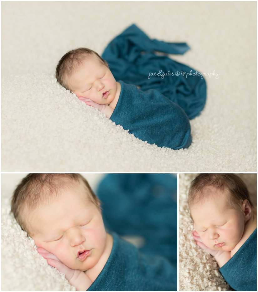newborn baby boy in blue wrap