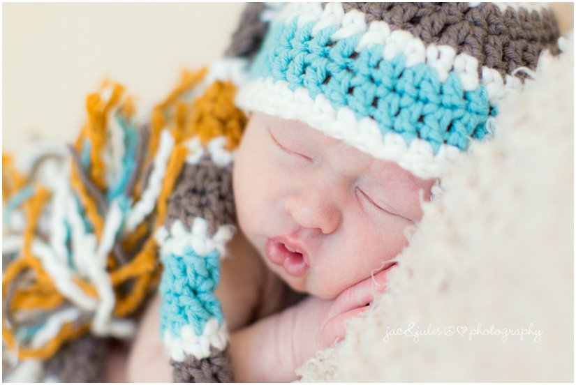 newborn baby boy in long crochet sleeper hat