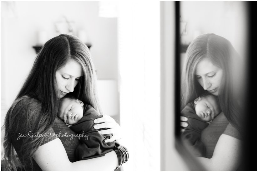 newborn baby boy with mom and reflection in black and white