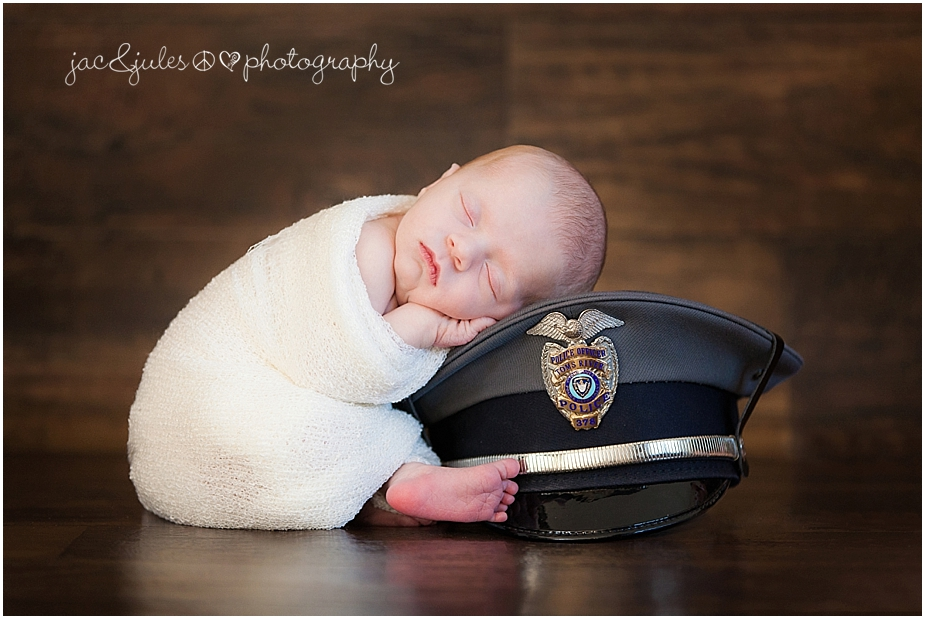 jacnjules photographs a newborn baby girl with her fathers police hat