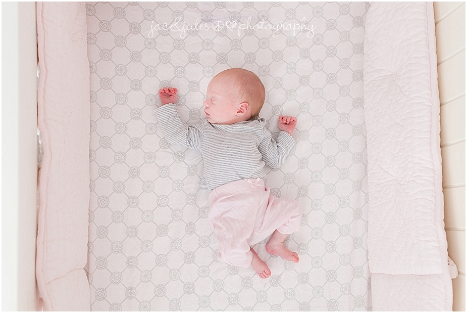 jacnjules photographs a newborn baby girl in her crib in her home in toms river nj