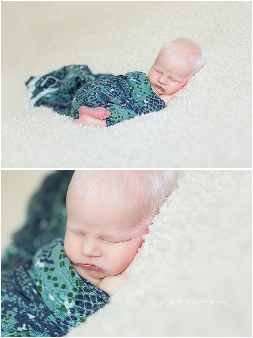 newborn baby boy wrapped in moms blue and green scarf