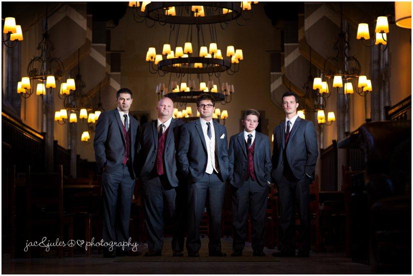 dramatic groomsmen photo in dining hall at princeton university