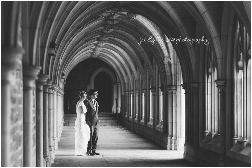 dramatic black and white photo of bride and groom in the corridor on their winter wedding at Princeton University