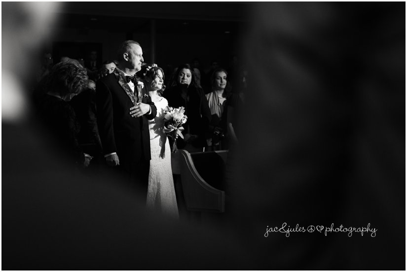 dramatic black and white photography of father walking the bride down the aisle