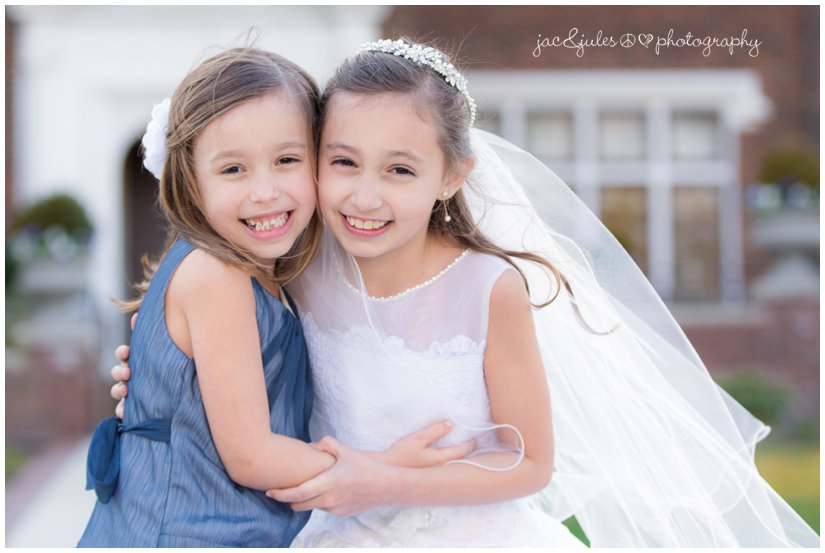 communion girl with her little sister