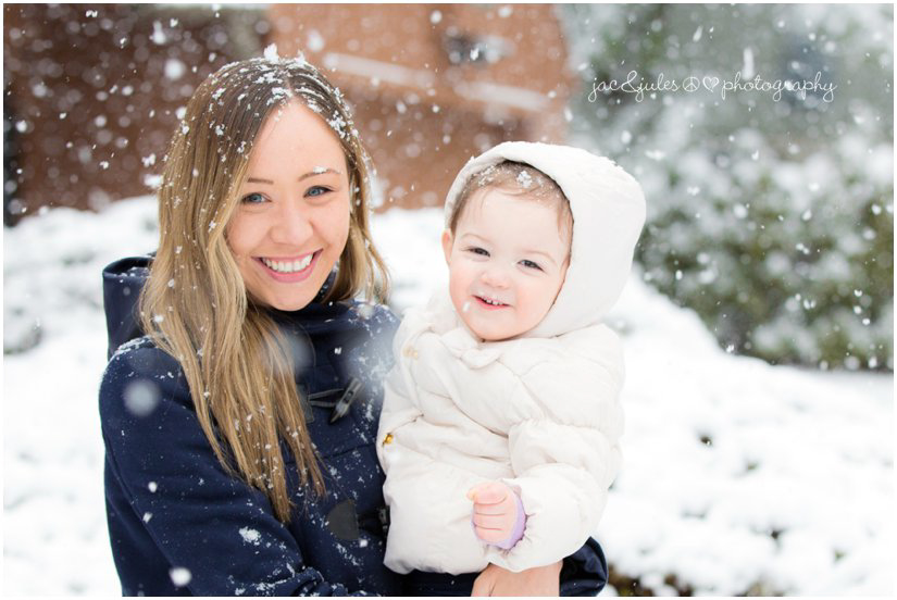 little girl in the snow with her aunt from Australia