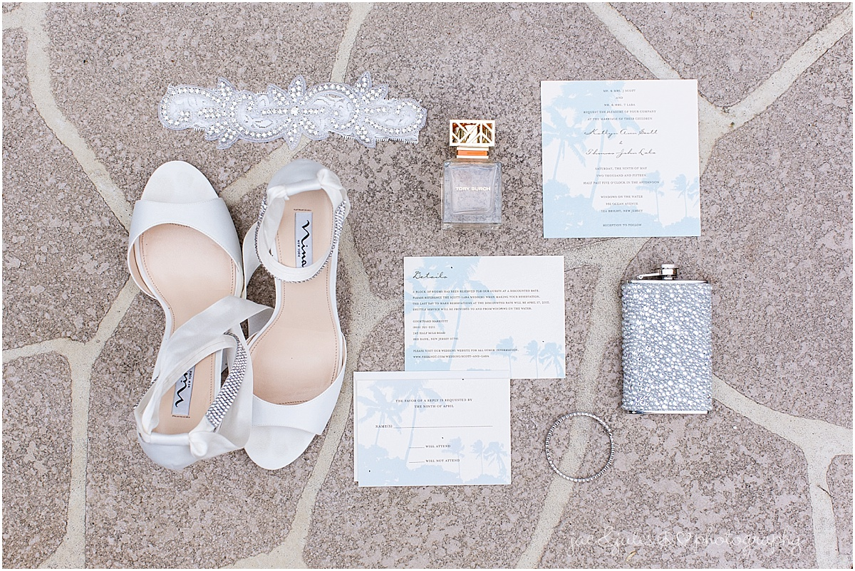 brides accessories shoes, beaded flask, tori burch perfume, jewelry, invitations and stationary, and garter.