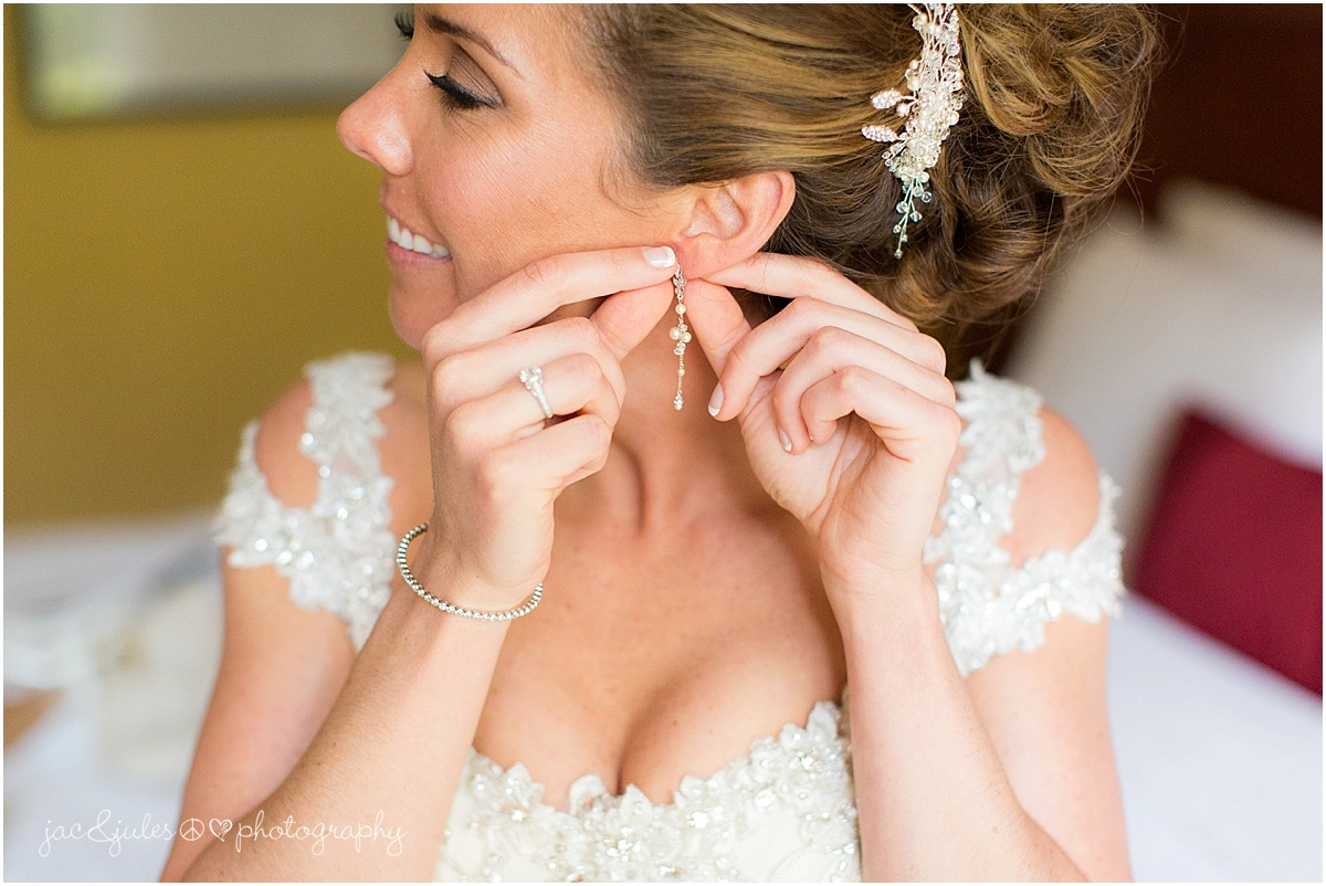 bride putting on earrings from foolish ginger in asbury park, nj