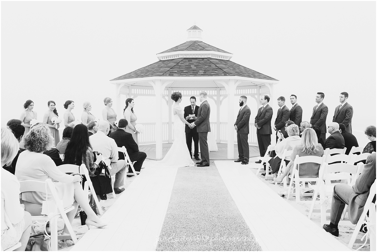 black and white photo of beach wedding ceremony