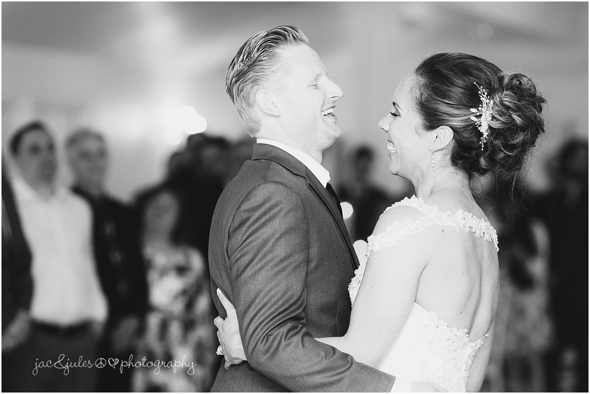 black and white of bride and groom first dance.