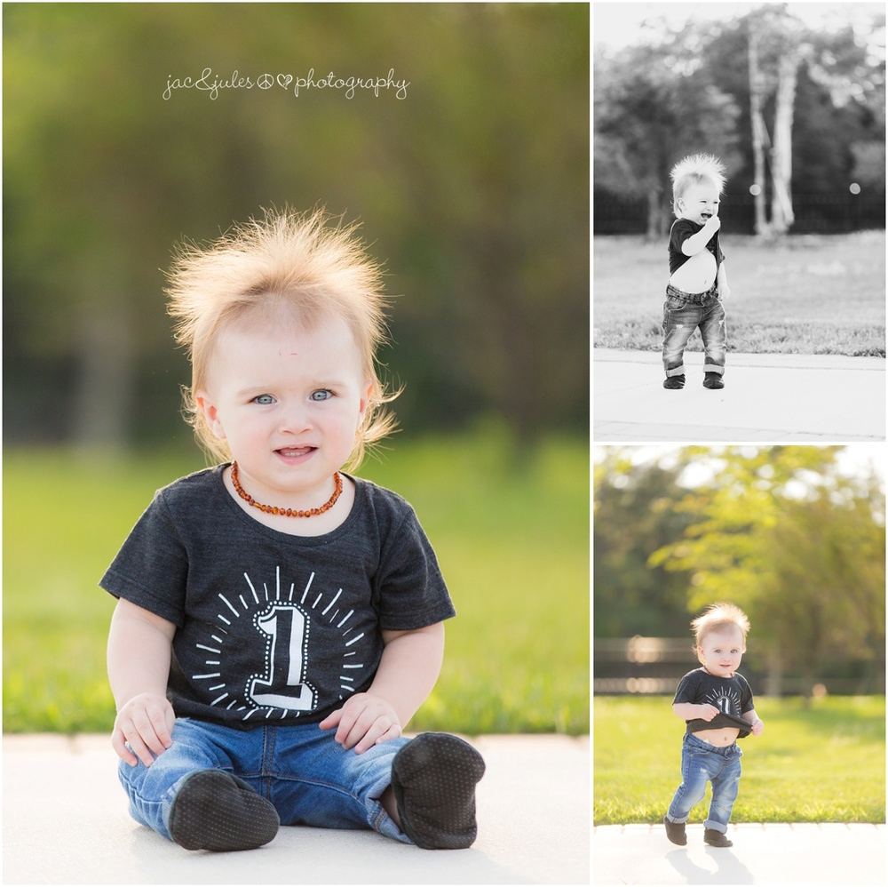 1 year old boy in black birthday t shirt and amber teething necklace