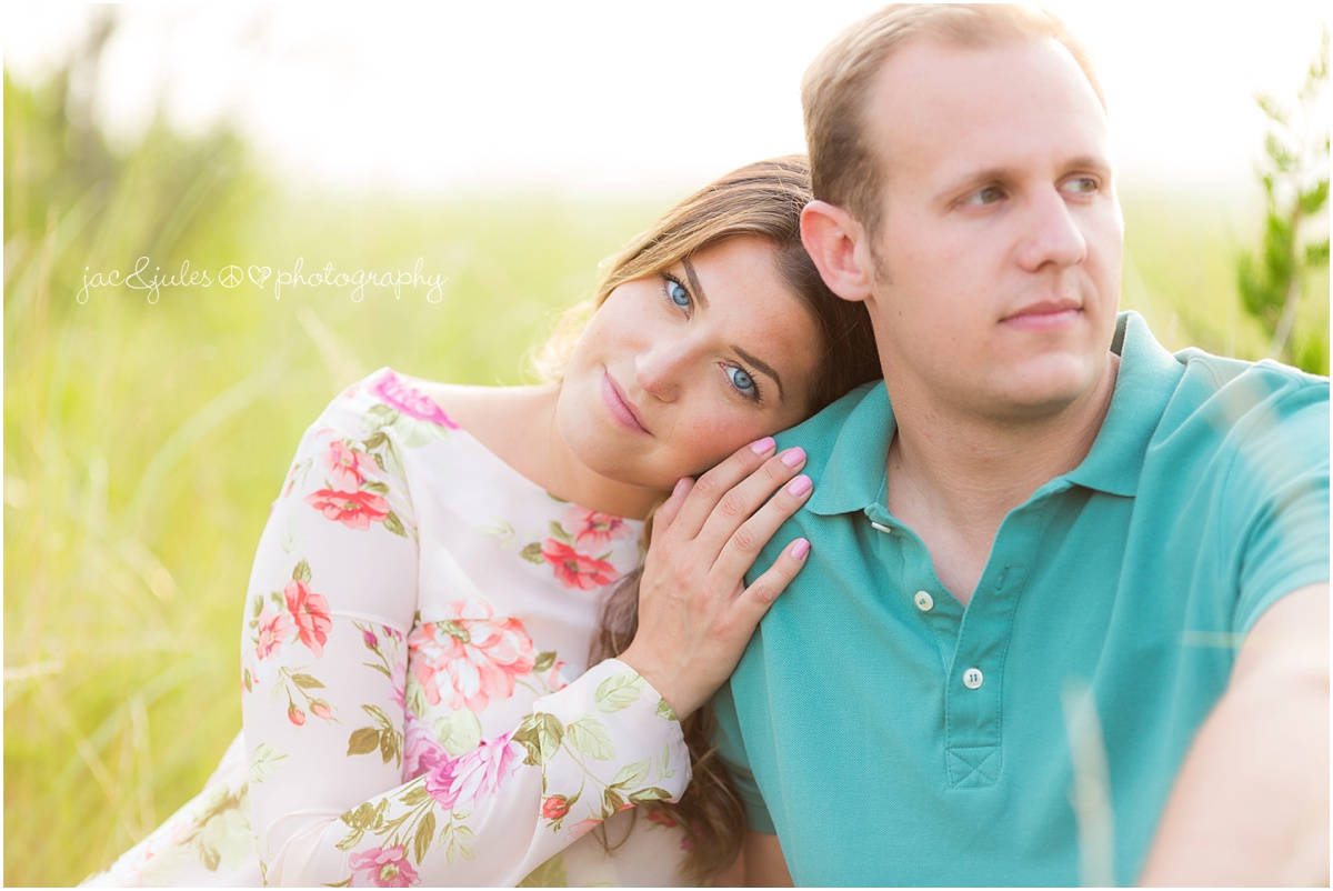bride to be with gorgeous blue eyes in the dunes on the barnegat bay