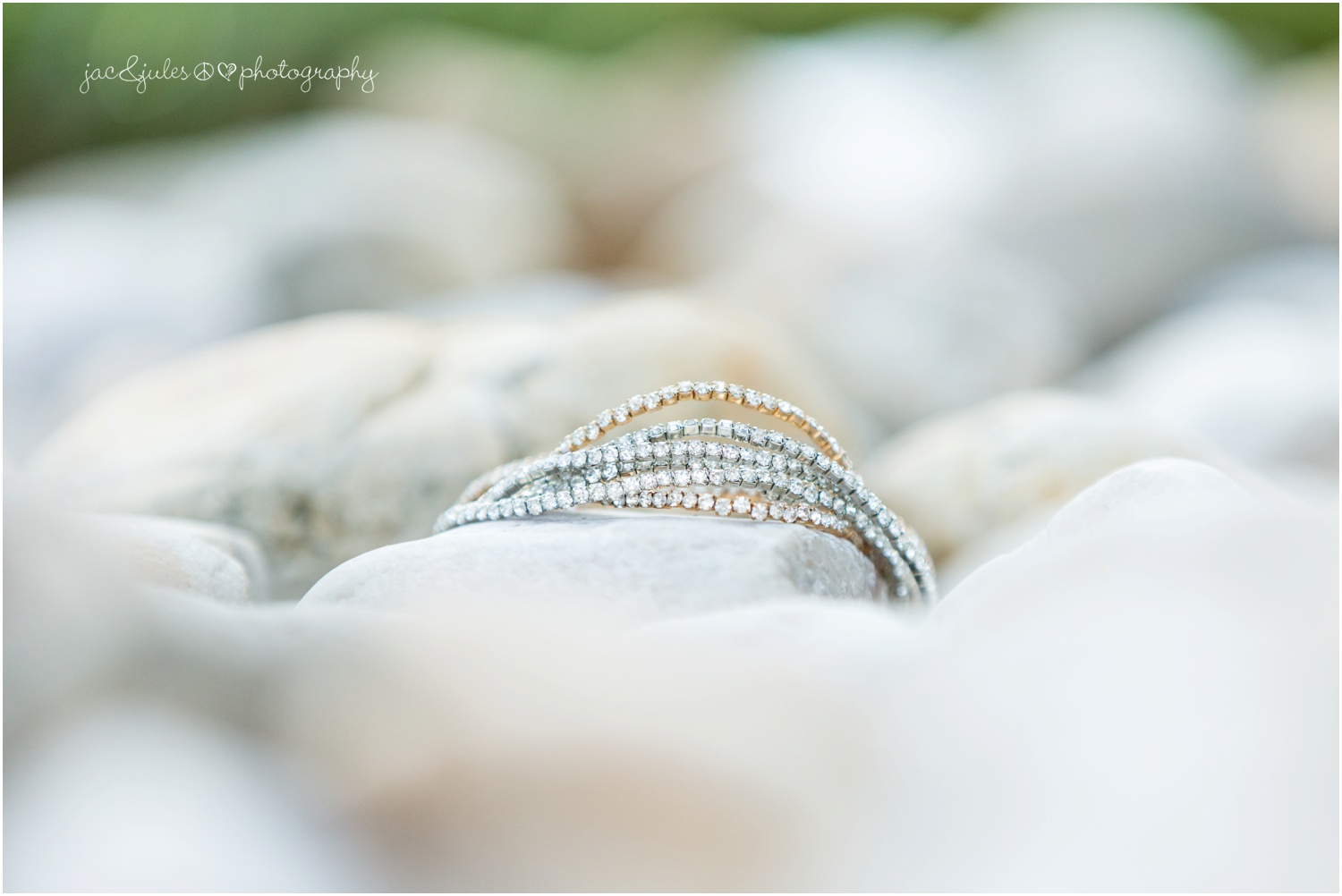 bride's bracelets in a rock bed at her house