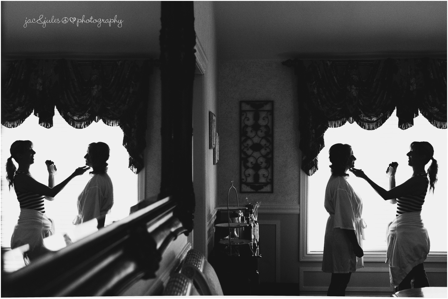 silhouette of make up artist and bride and reflection