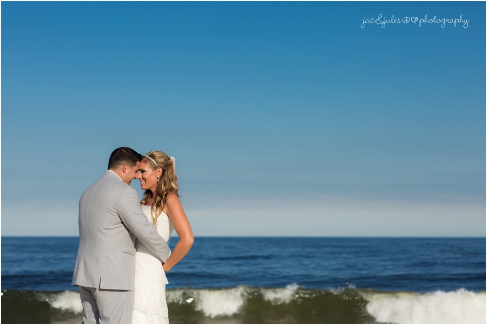 bride and groom with ocean in the background
