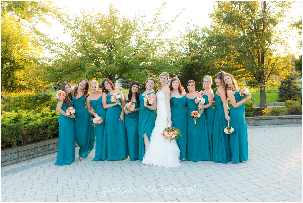 jacnjules photographs bridesmaids in blue at windows on the water at frogbridge