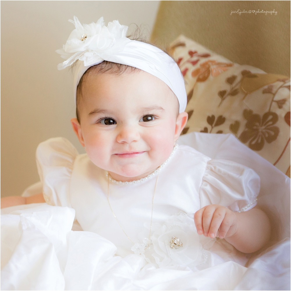 angelic close up of baby girl in christening gown
