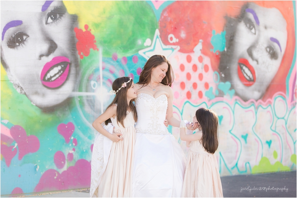jacnjules photographs a bride and her girls near graffiti in Asbury Park NJ