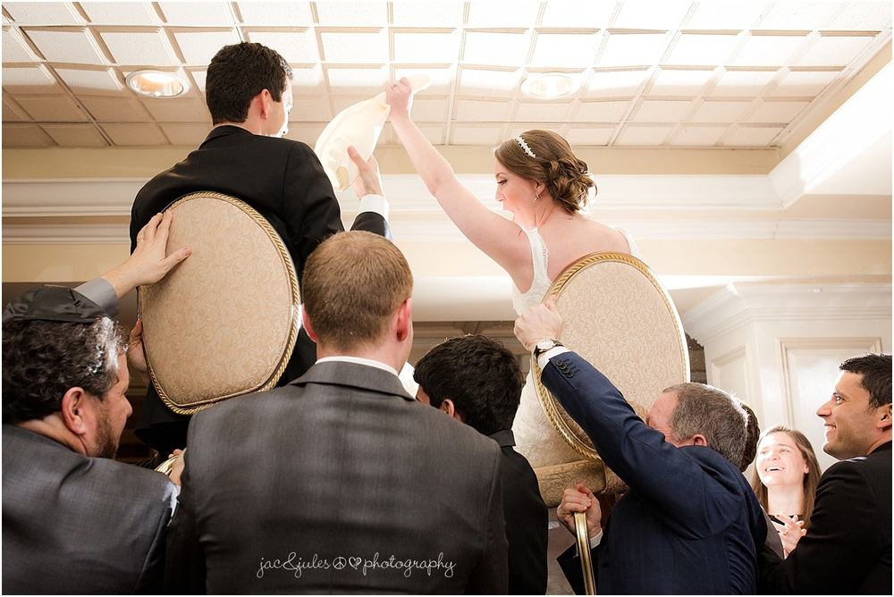 jacnjules photograph the horah for a jewish wedding at the olde mill inn in basking ridge nj