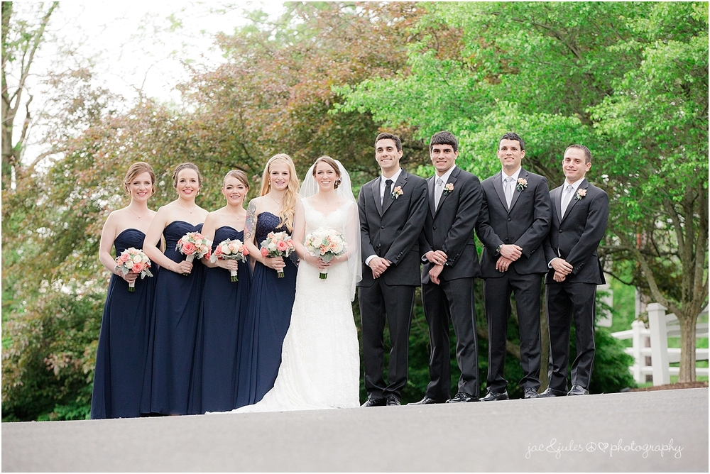 jacnjules photograph fun bridal party at the olde mill inn in basking ridge nj