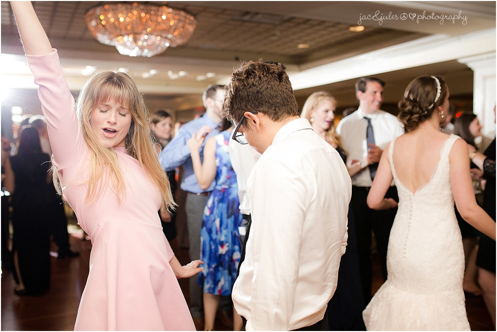 jacnjules photographs fun wedding reception at olde mill inn in basking ridge nj