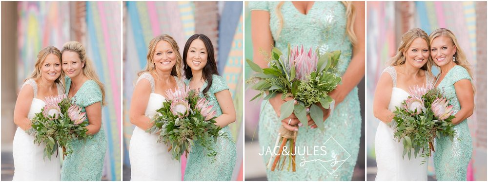 jacnjules photographs beautiful bridesmaids with trendy bouquets against the murals in asbury park, nj