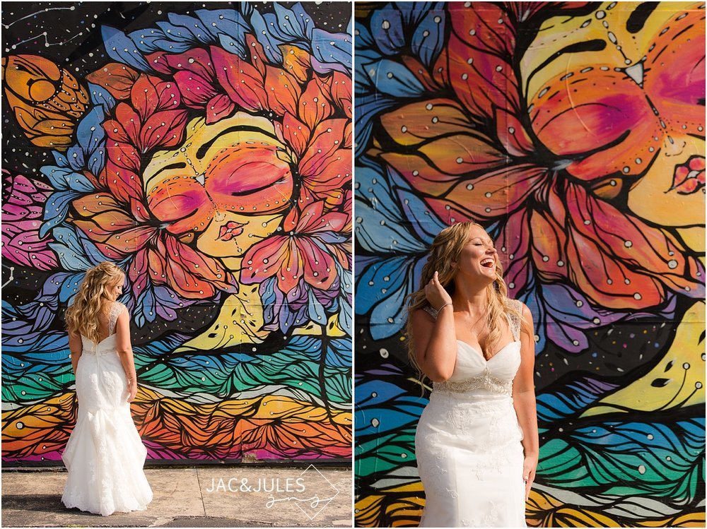 jacnjules photographs beautiful bride against the murals in asbury park, nj