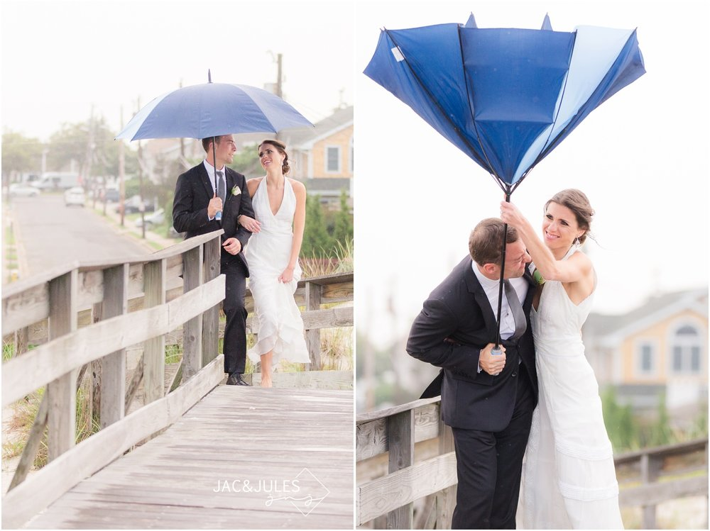 bride and groom with umbrella on the beach in the rain in Long Island, NY