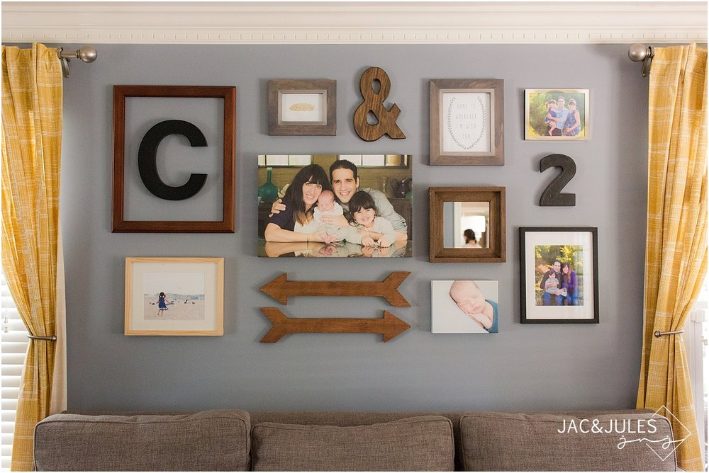 jacnjules photographs a rustic wall display of portraits and arrows