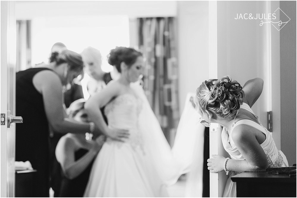 jacnjules photograph a bride getting ready for her wedding at Wilshire Grand Hotel in West Orange, NJ