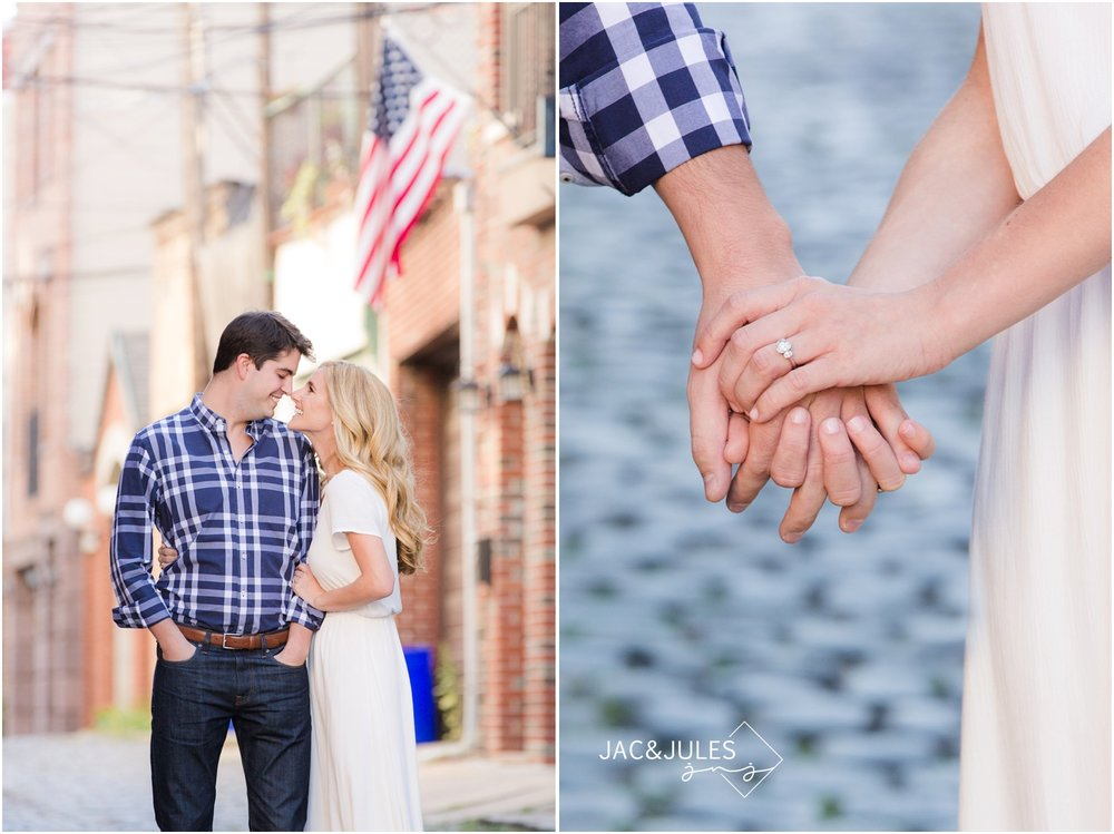 engagement photos with american flag on cobblestone street in hoboken, nj.