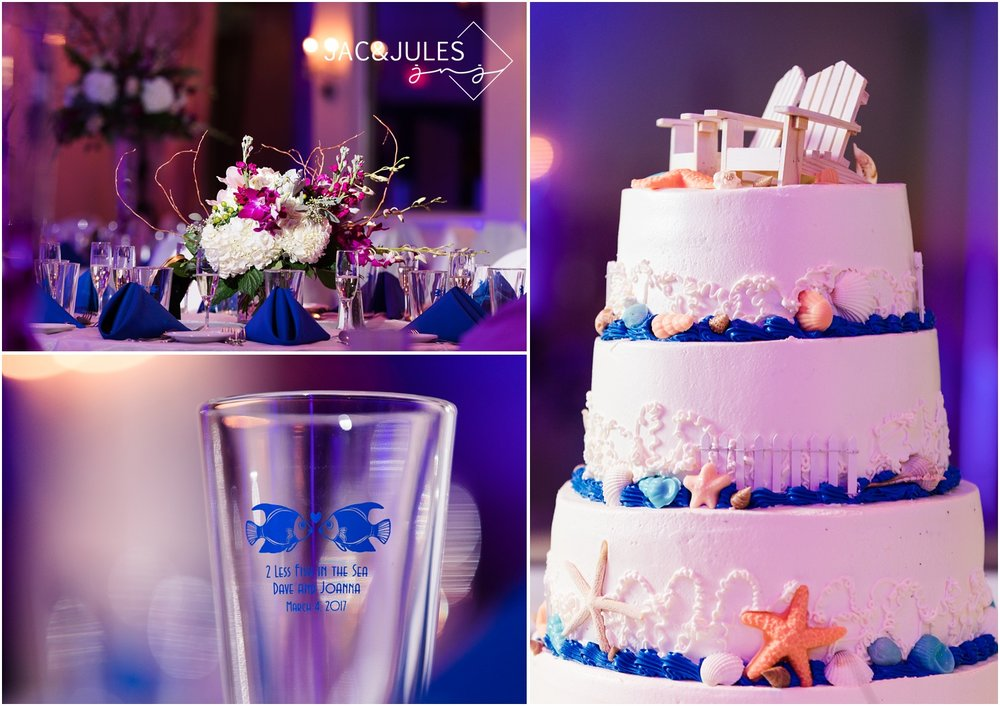 Floral centerpiece by Narcissus Florist, beach themed wedding cake, and pint glass wedding favors photographed in the ballroom at The Lobster Shanty in Point Pleasant, NJ.