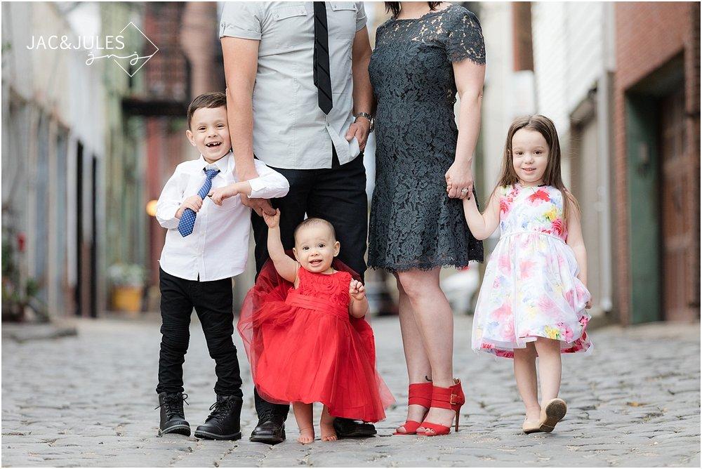 jacnjules photographs family on cobblestone street in Hoboken NJ