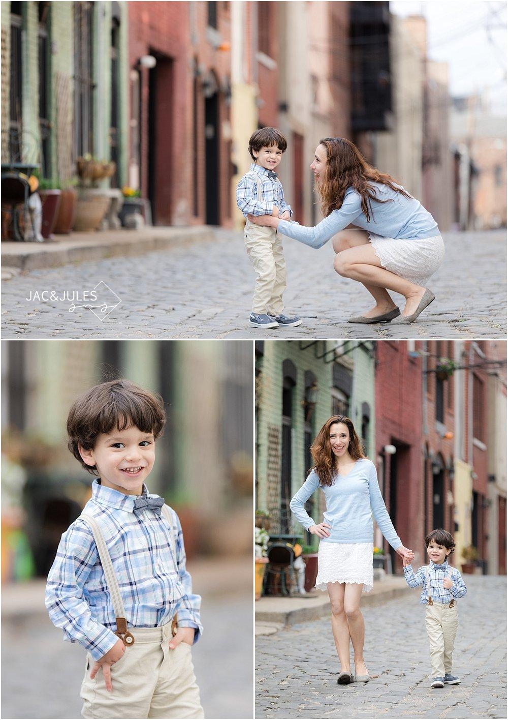 jacnjules photographs mother and son on cobblestone street in Hoboken NJ